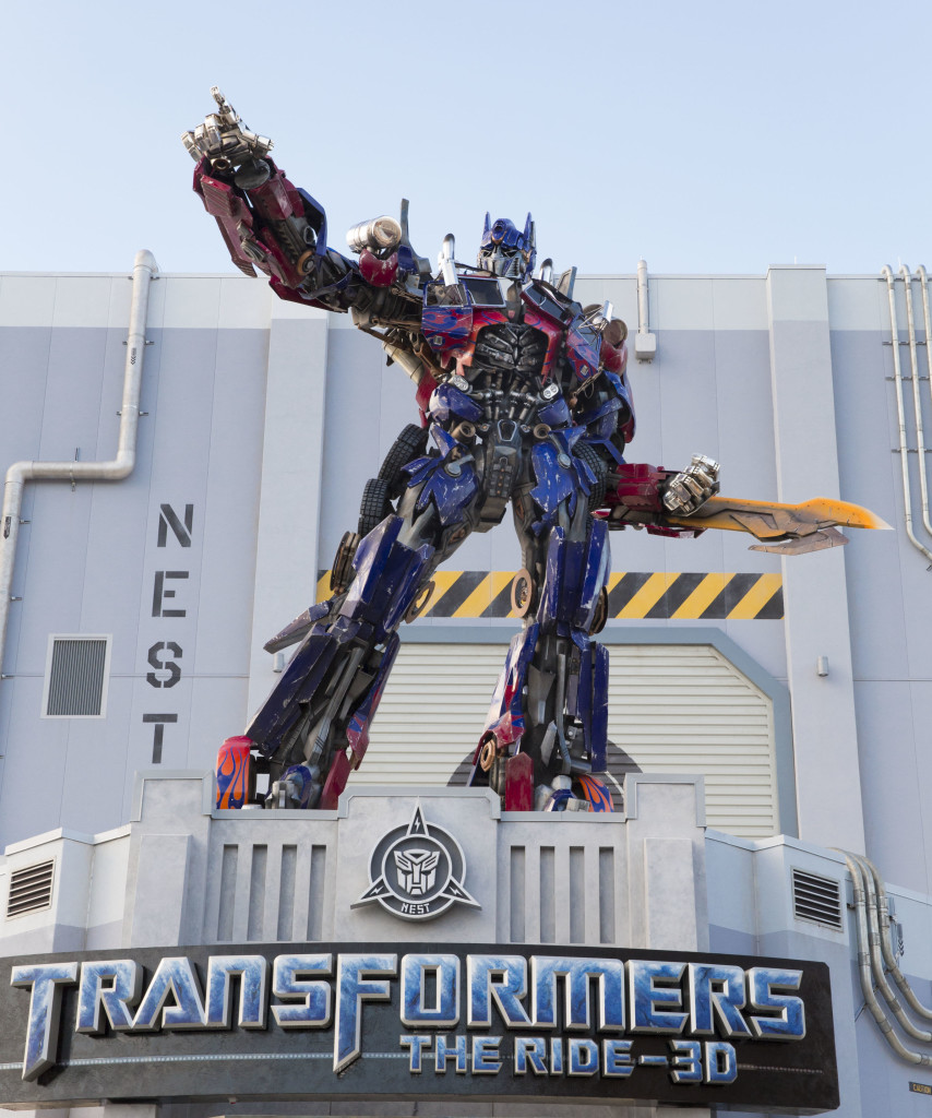 Optimus Prime is ready for battle – towering above the entrance to Universal Orlando Resort's highly-anticipated, blockbuster attraction, TRANSFORMERS: The Ride – 3D. The addition of the authentically-sized leader of the Autobots Thursday morning, May 30, 2013 is one of the finishing touches to the attraction. Optimus Prime stands guard at 28 feet tall and nearly nine tons, beckoning recruits to join the resistance against the invading Decepticons. The mind-blowing, action-packed thrill ride, which was constructed in record time, officially opens June 20 at Universal Studios Florida.